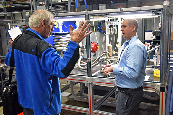 AFRL team members discuss the new heat exchange tester